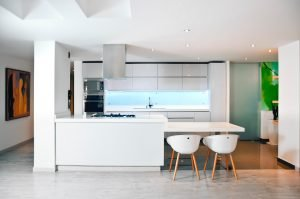 Creating a dining area extension off the kitchen bench frees up room for a large living area or a study nook
